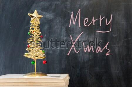 Chalkboard writing - Merry Christmas Stock photo © raywoo