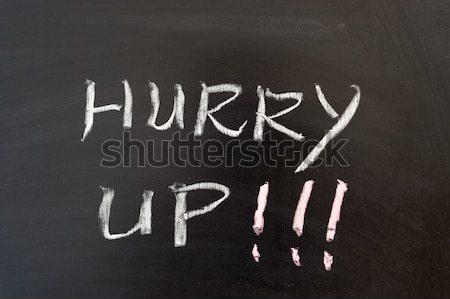 Dépêchez up mots écrit tableau écrit Photo stock © raywoo