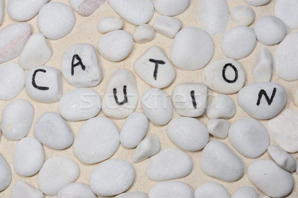 Ostrożność słowo grupy piasku tekstury Zdjęcia stock © raywoo