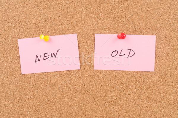 Novo velho palavras escrito papel placa de cortiça Foto stock © raywoo