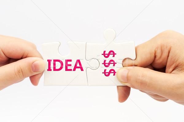 Idéia dinheiro dois mãos peças do puzzle Foto stock © raywoo