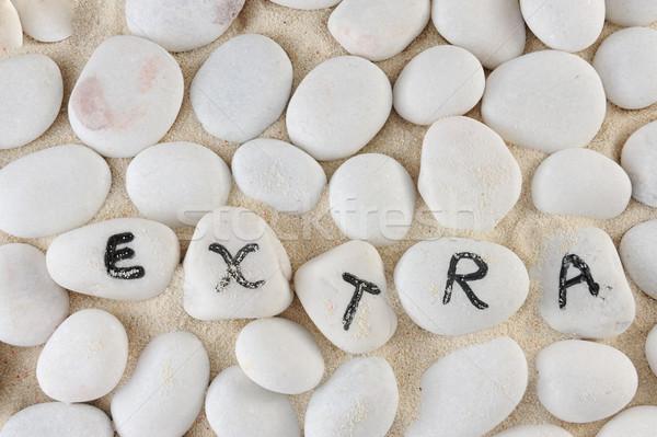 Extra palabra grupo piedras arena textura Foto stock © raywoo