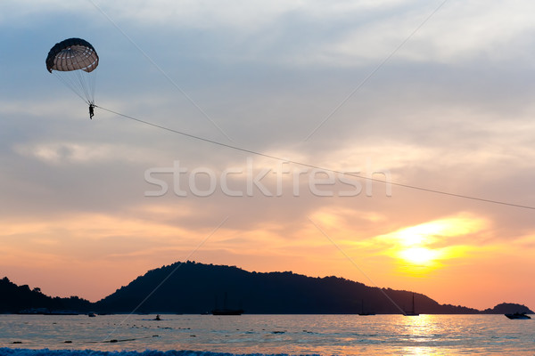 Parasailing at sunset Stock photo © raywoo