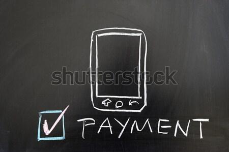 AD word with mobile phone on blackboard Stock photo © raywoo