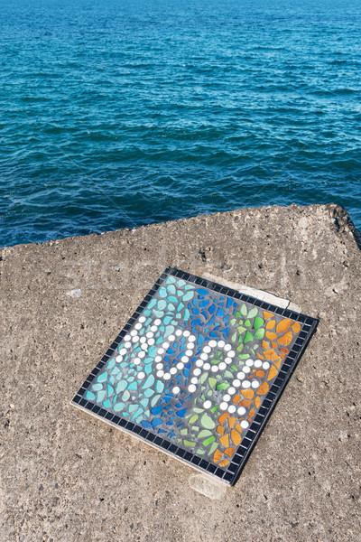Umut kelime küçük taşlar deniz mavi Stok fotoğraf © raywoo