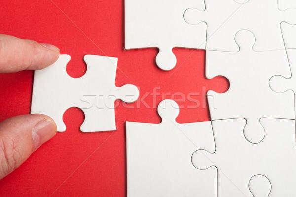 Quebra-cabeça mão peça grupo branco Foto stock © raywoo