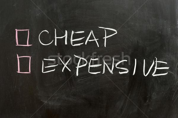 Ucuz pahalı seçenekleri kara tahta finanse tahta Stok fotoğraf © raywoo