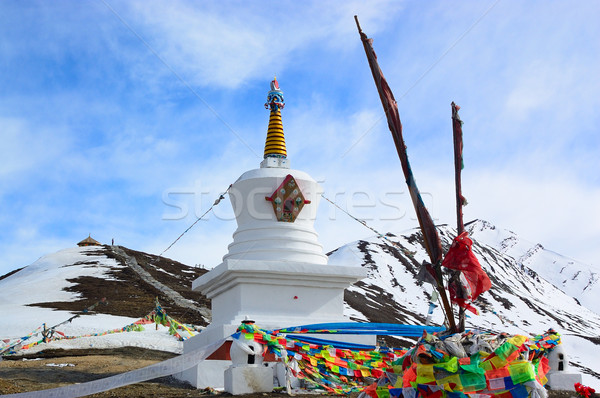 White Tibetan pagoda near snow mountain Stock photo © raywoo