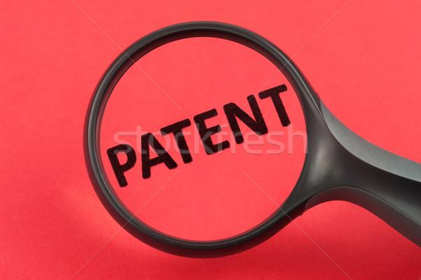 Patente lupa mão negócio pesquisa Foto stock © raywoo