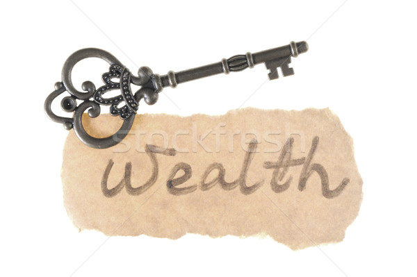 Old key and wealth word Stock photo © raywoo