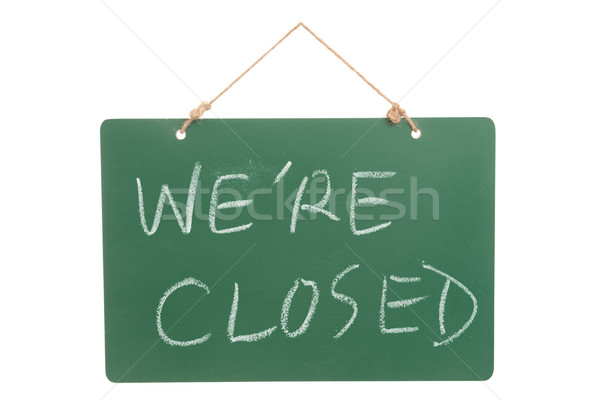 We're closed words on green board Stock photo © raywoo