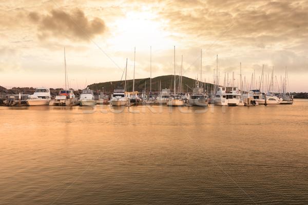 Porto paisagem grupo água pôr do sol navio Foto stock © raywoo
