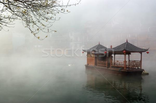 China landscape of boat on foggy river Stock photo © raywoo