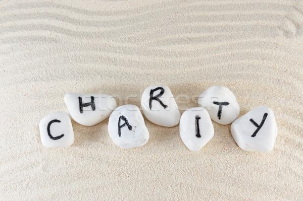благотворительность слово группа камней песок деньги Сток-фото © raywoo