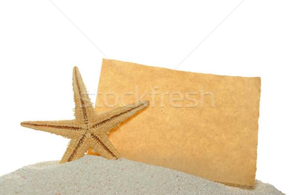 Starfish papel velho areia isolado branco praia Foto stock © raywoo