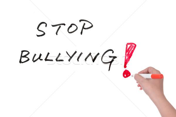 Stop megfélemlítés szavak írott fehér tábla kéz Stock fotó © raywoo