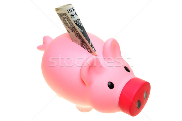 Piggy bank with dollar bill Stock photo © raywoo