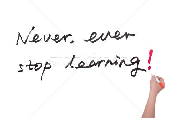 Asla durdurmak öğrenme sözler yazılı beyaz tahta Stok fotoğraf © raywoo