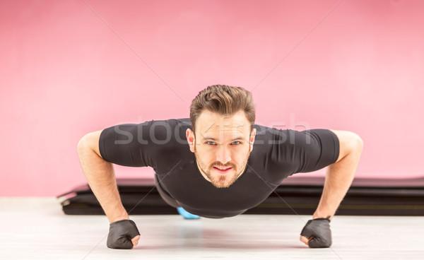 Portrait of a Young Man Doing Pushups Stock photo © RazvanPhotography