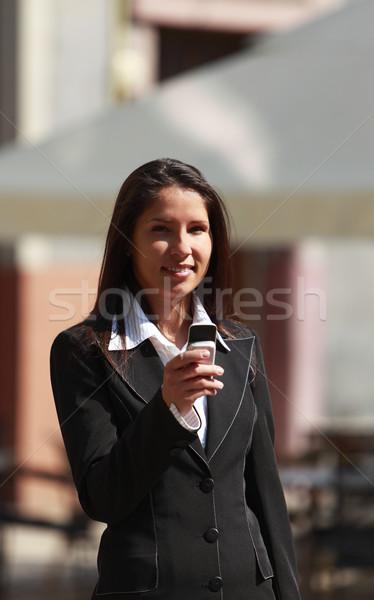 女性実業家 携帯電話 市 女性 電話 インターネット ストックフォト © RazvanPhotography