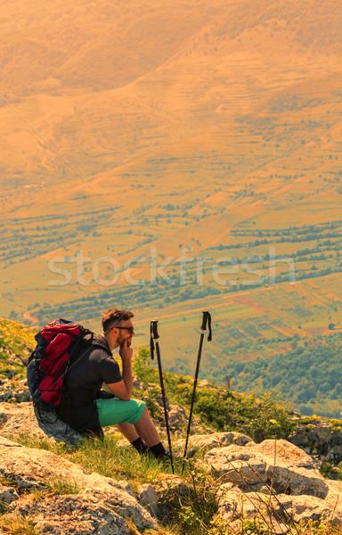 Hiker Resting on Rocks in Mountains Stock photo © RazvanPhotography