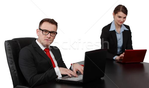 Young Business Couple on Laptops Stock photo © RazvanPhotography