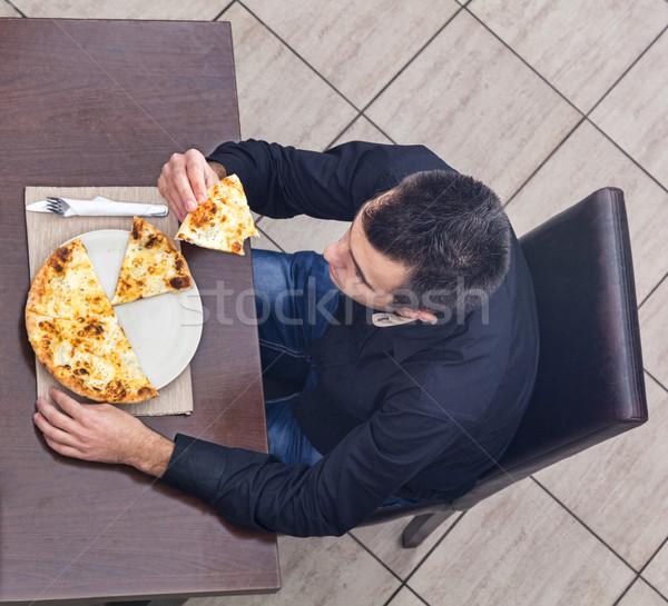 Young Man Eating Pizza Stock photo © RazvanPhotography