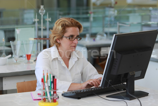 Female researcher working on a computer in a laboratory. Stock photo © RazvanPhotography