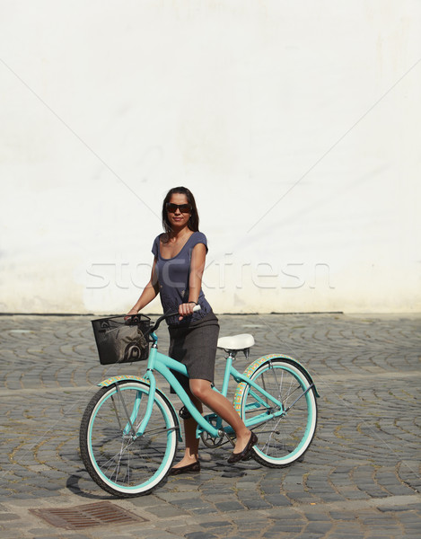 Woman With A Bicycle In A City Stock photo © RazvanPhotography