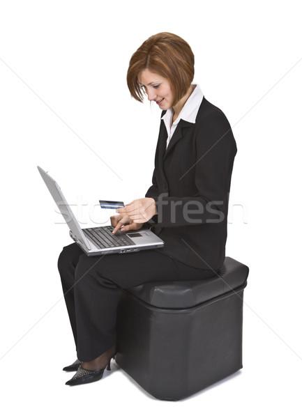 online kaufen gesch ftsfrau sitzung kaufen etwas stock foto radu razvan gheorghe. Black Bedroom Furniture Sets. Home Design Ideas