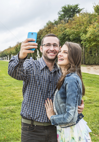 Happy Couple taking a selfie in a French Garden Stock photo © RazvanPhotography