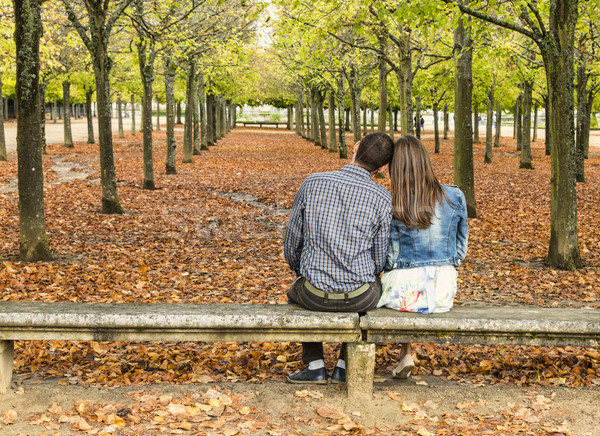 Young Couple Sitting on a Bench in a Park in Autumn Stock photo © RazvanPhotography
