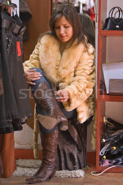Woman trying on new boots Stock photo © RazvanPhotography