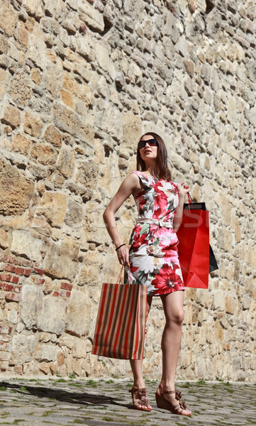 Young Woman with Shopping Bags in a City Street Stock photo © RazvanPhotography