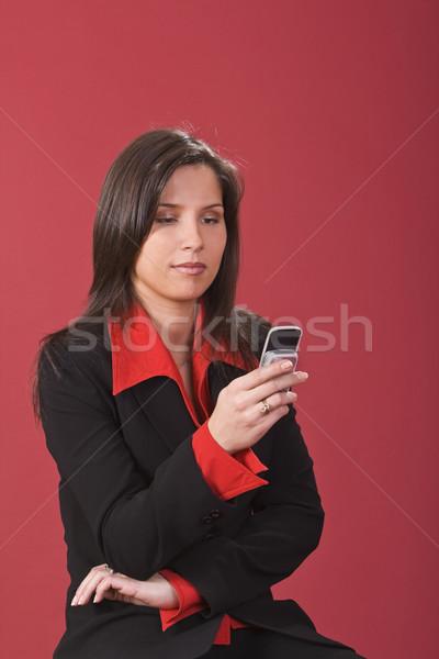Checking the mobile phone Stock photo © RazvanPhotography