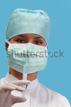 Feminino enfermeira isolado azul médico Foto stock © RazvanPhotography