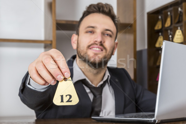 Recepcionista clave imagen escritorio cliente atención selectiva Foto stock © RazvanPhotography