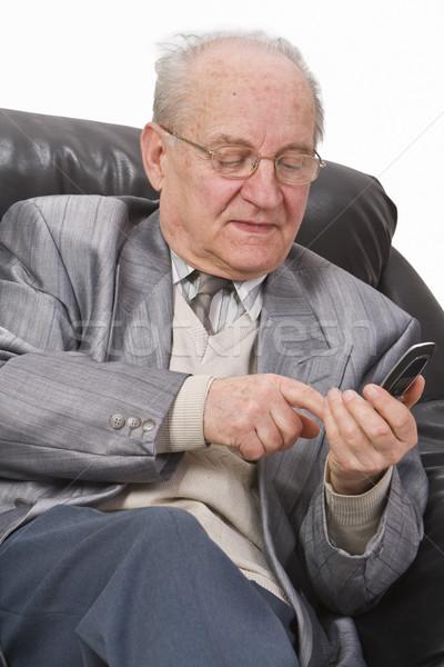 Senior using a mobile phone Stock photo © RazvanPhotography