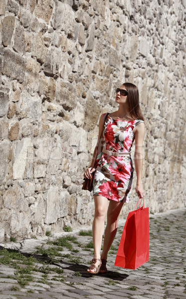 Young Woman with Shopping Bag in a City Street Stock photo © RazvanPhotography