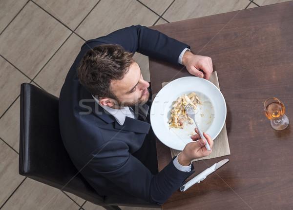 Man Eating Penne Pasta Stock photo © RazvanPhotography