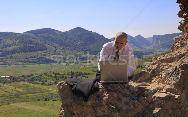 Businessman on a computer outdoors Stock photo © RazvanPhotography