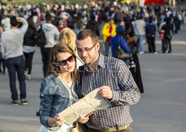 Couple with a Map in a Crowded City Stock photo © RazvanPhotography