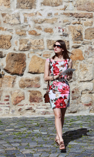 Young Woman Walking with a Tablet Stock photo © RazvanPhotography
