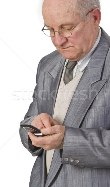 Stock photo: Senior man using a mobile phone
