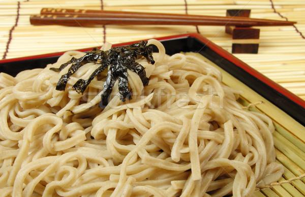 Soba and chopsticks on a bamboo floor Stock photo © RazvanPhotography