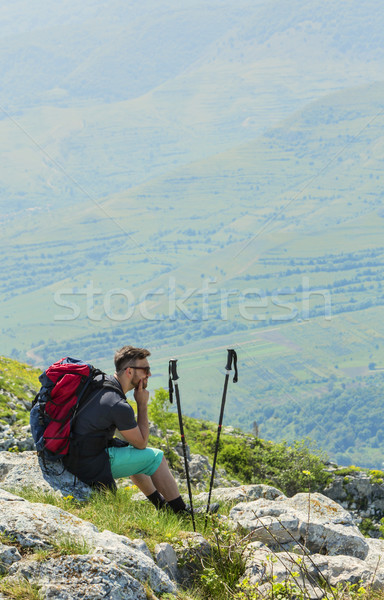 Stock photo: Hiker Resting on Rocks in Mountains
