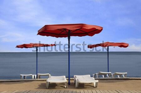 Image orange parasol blanche plage eau Photo stock © RazvanPhotography