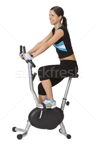 Fitness meisje paardrijden fiets witte vrouw Stockfoto © RazvanPhotography