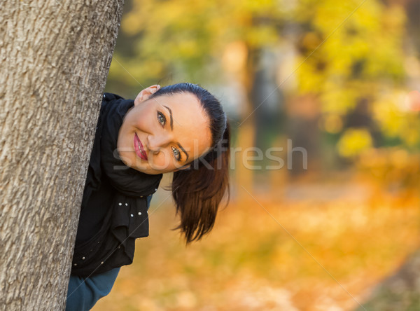 Woman Hiding Behind a Tree Stock photo © RazvanPhotography