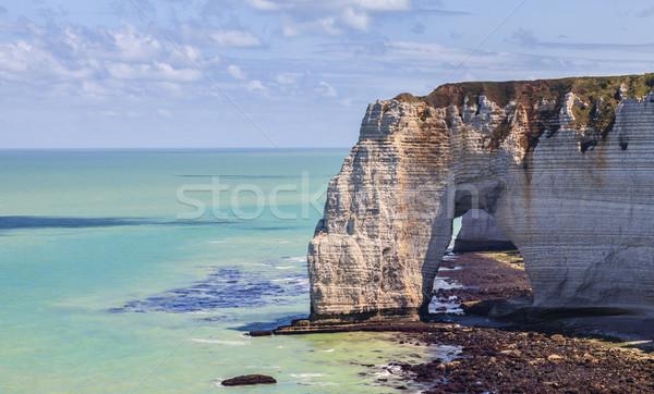 Természetes kő ív Normandia alacsony árapály Stock fotó © RazvanPhotography